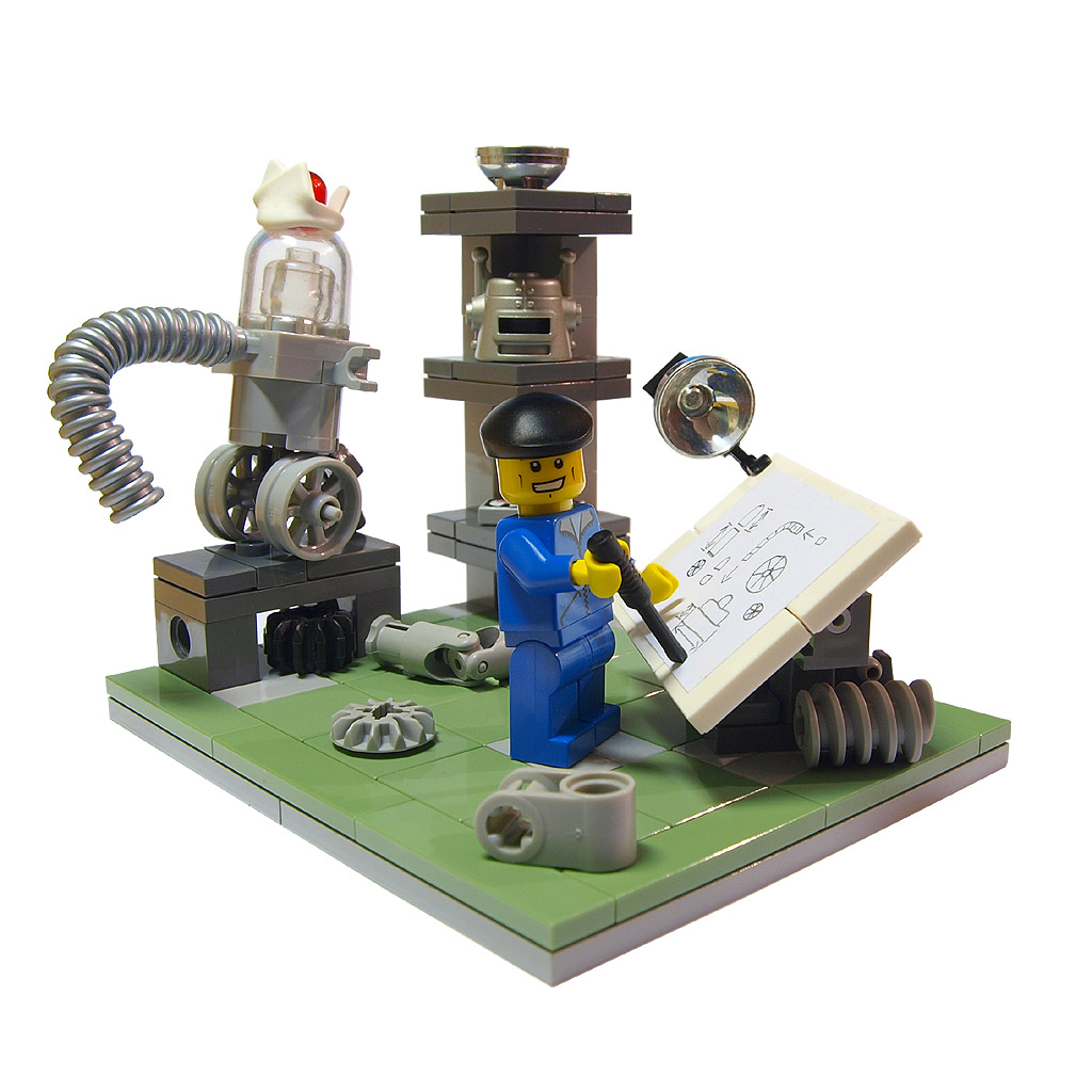 "A yellow Lego figure ""wearing"" a blue uniform stands at the center of a green tile platform. The figure holds a black stick that touches a paper laid out on a drawing board in front of him. The paper has several schematics hand-drawn on it. The drafting table, which is made of white plastic tiles and grey plastic cubes and spirals, has a mini spotlight attached to it. Behind the inventor is some sort of machine -- it has a clear bubble on top of a grey wheeled cart with a corrugated pipe extending from it. On a shelf in the background, several plastic parts are stacked. Other plastic parts are on the floor surrounding the figure."