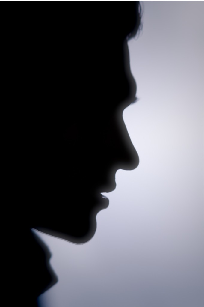 Shadow profile of a man's face.