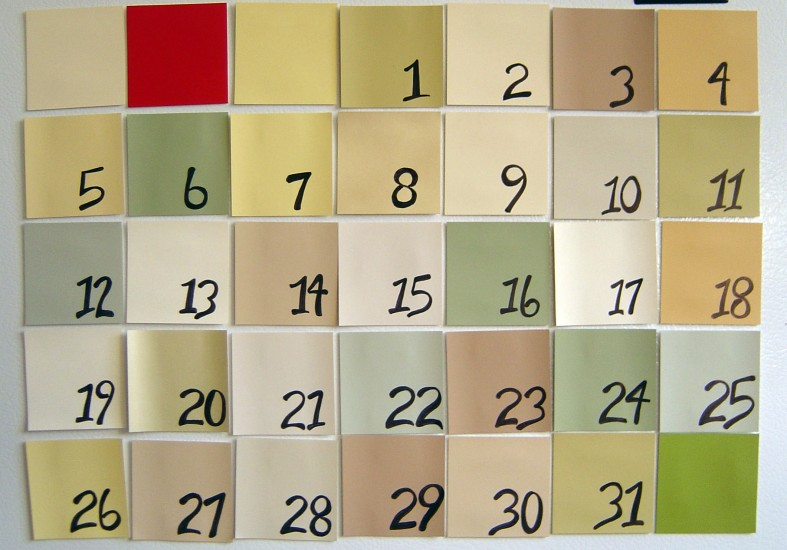 35 different colored squares are arranged in a calendar grid. 31 of the squares are labeled with the numbers 1 through 31, representing days of the month.