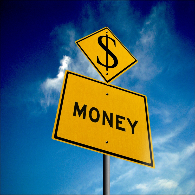 "Road signs representing money ahead. A diamond-shaped, yellow caution sign has a $ printed on it and sits atop a square yellow information sign with the word ""MONEY"" printed on it."