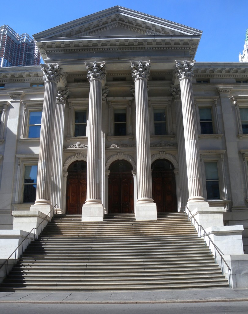 Looking south across Chambers Street at the central portico of Tweed Courthouse (which now houses the NYC Department of Education) on a sunny morning.