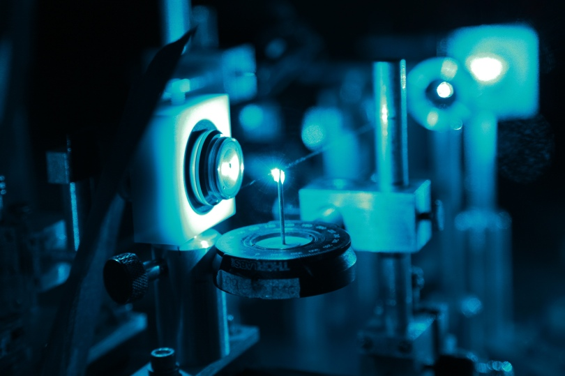 Micro-focusing an Argon-ion laser onto a graphene sample