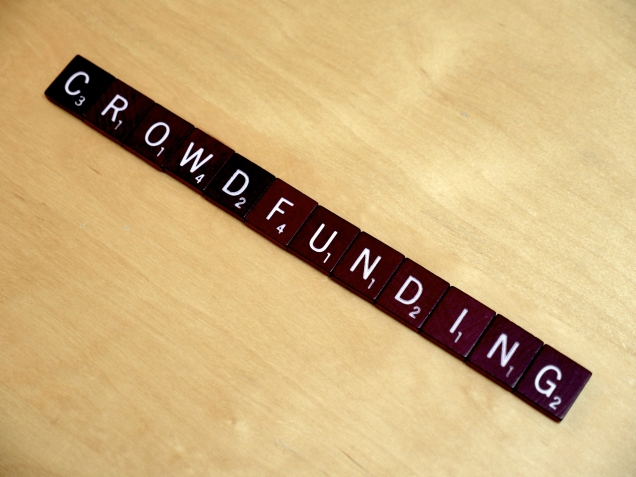 "The word ""Crowdfunding"" is spelled out using Scrabble tiles."
