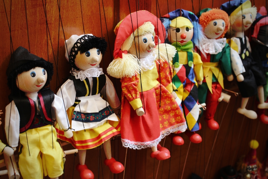 A row of marionettes.