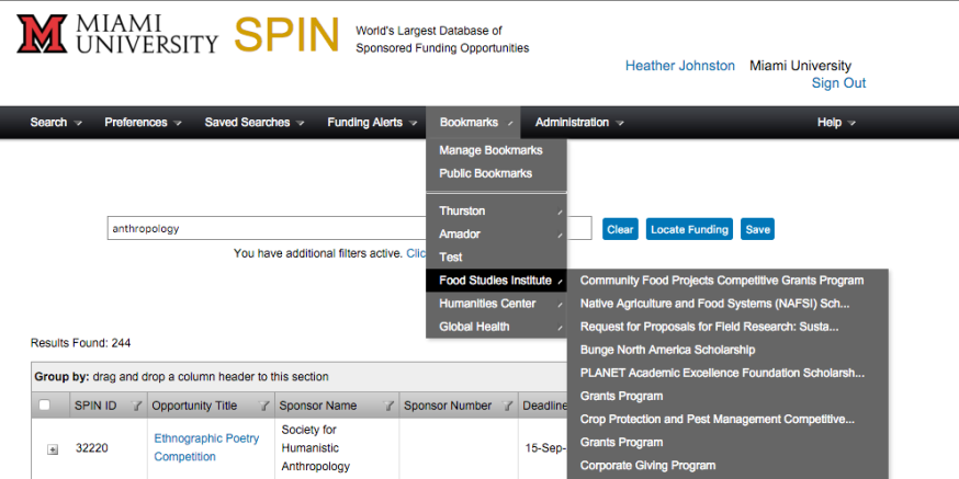 Screenshot of SPIN with Bookmarks menu expanded. Visible text: Miami University. SPIN. World's Largest Database of Sponsored Funding Opportunities. Heather Johnston. Miami University. Sign Out. Menu Ribbon: Search. Preference, Saved Searches. Funding Alerts. Bookmarks. Administration. Help. Bookmarks menu: Manage Bookmarks. Public Bookmarks. Thurston. Amador. Test. Food Studies Institute. Humanities Center. Global Health. Food Studies Institute option expanded: Community Food Projects Competitive Grants Program. Native Agriculture and Food Systems (NAFSI) Sch . . . Request for Proposals for Field Research: Susta . . . Bunge North America Scholarship. PLANET Academic Excellence Foundation Scholarsh . . . Grants Program. Crop Protection and Pest Management Competitive . . . Grants Program. Corporate Giving Program. Search results box: Results Found: 244. Group by: drag and drop a column header to this section. Column headers: SPIN ID. Opportunity Title. Sponsor Name. Sponsor Number. Deadline . . . Table Row 1: +. 32220. Ethnographic Poetry Competition. Society for Humanistic Anthropology. 15-Sep . . .