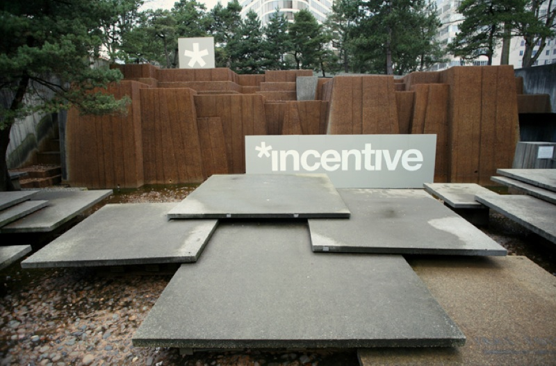 "A sculpture garden. The word ""incentive"" appears on a piece of sculpture."