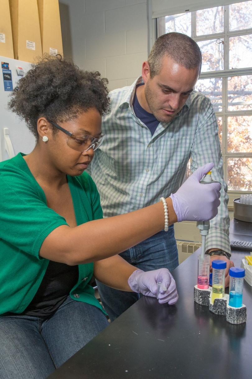 Assistant professor of chemistry, Rick Page, works in a lab with undergraduate student Chanell Upshaw.