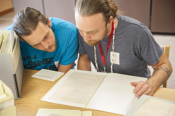 The Tututni language team works at the Smithsonian National Anthropological Archives during the 2015 National Breath of Life Archival Institute for Indigenous Languages workshop