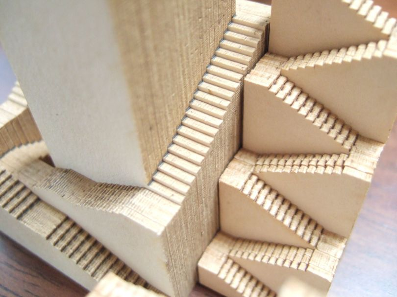 Algorithmic stair steps carved into a piece of wood.