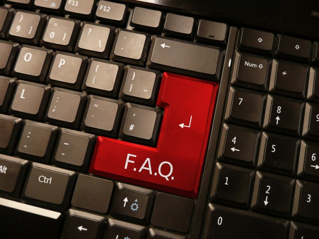 Computer keyboard with an FAQ key in place of a return/enter key.