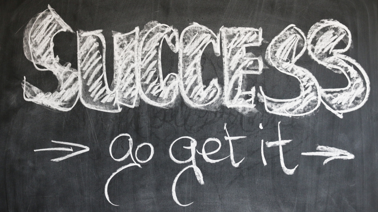 These words are written in chalk on a chalkboard: Success. Go get it.