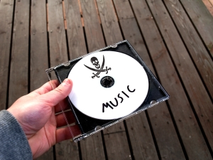CD with skull and crossbones icon and 'music' text.