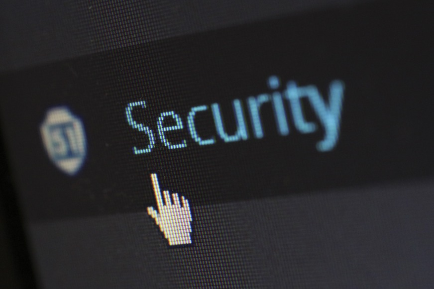 """The word """"security"""" and a pointing finger icon appear on a computer screen."""