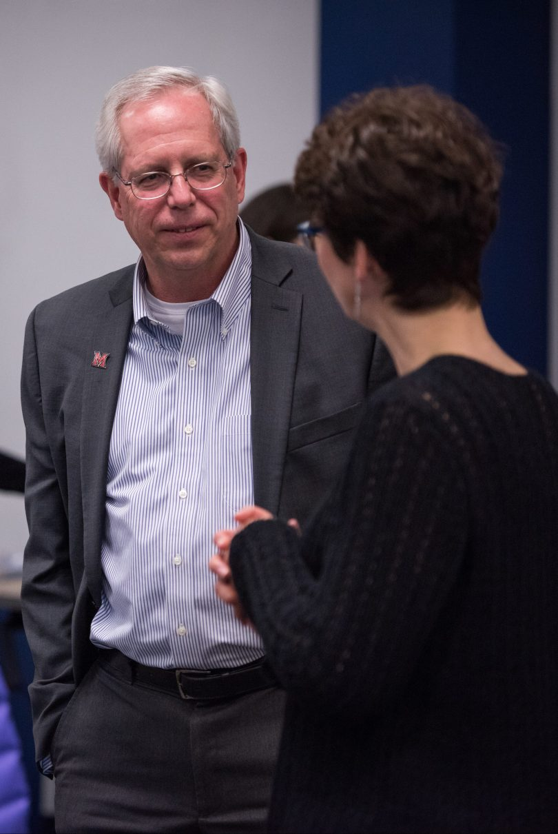 Jim Oris talks to Associate Dean Ann Frymier.