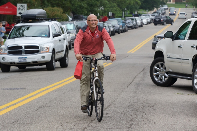 Miami University president, Dr. Gregory Crawford, rides his bike on Miami's campus, in Oxford, Ohio.