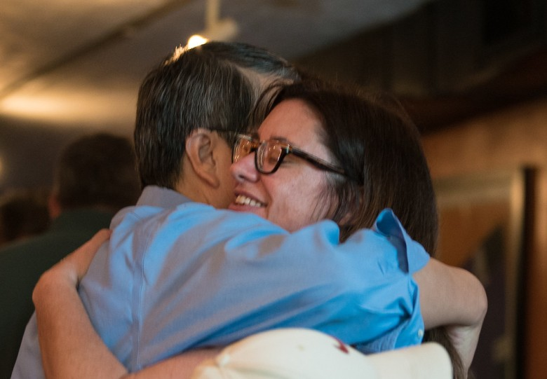Tricia Callahan gets a hug goodbye from Miami professor Ben Gung.