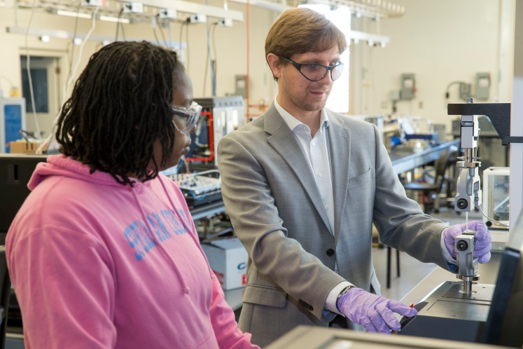Dominik Konkolewicz and a student work with some equipment in Konkolewicz's lab.