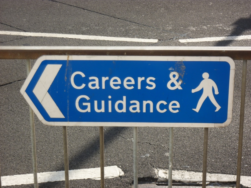 "Directional street sign reads, ""Careers & Guidance."""