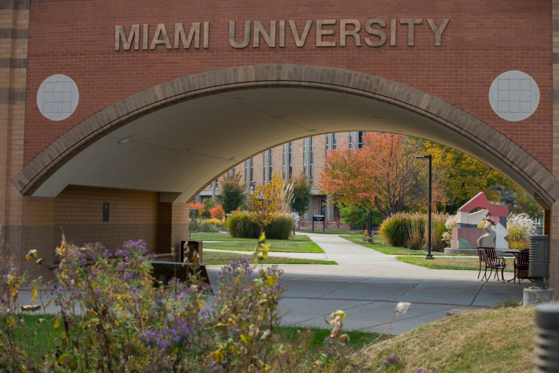 "Miami University's Hamilton campus. A building is seen through an arch with ""Miami University"" signage."