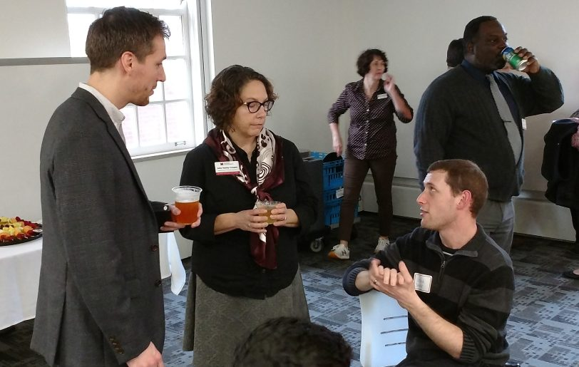 Attendees at OARS 8th Annual Proposals & Awards Reception. In the foreground, Regionals staff member Scott Berry and OARS staff member Amy Cooper talk with Regionals faculty member Leland Spencer.