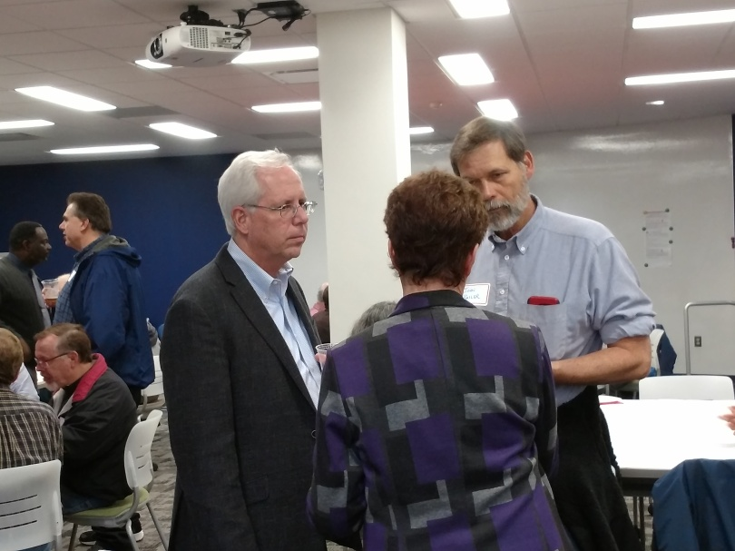 Attendees at OARS 8th Annual Proposals & Awards Reception. In the foreground, Associate Provost for Research Jim Oris talks with professor of statistics John Bailer and Director of the Scripps Gerontology Center, Suzanne Kunkel.