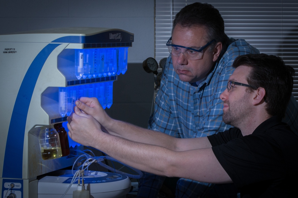 Gary Lorigan and Dan Drew work with an EPR spectrometer.
