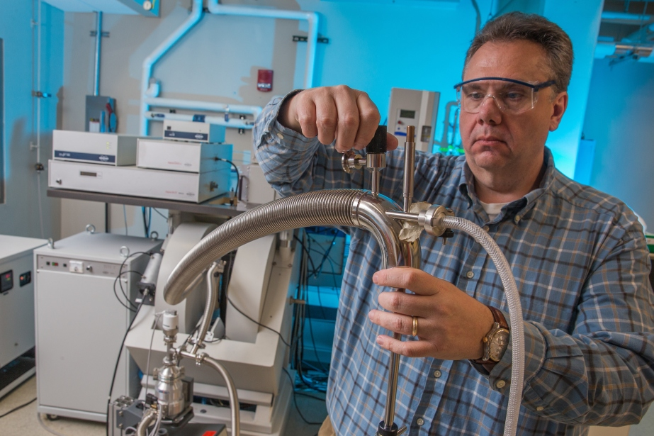 Gary Lorigan works with a piece of equipment in his lab.