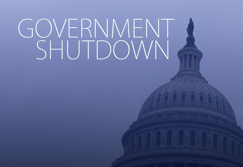 "Image of the Capitol Building with the words ""Government Shutdown"" overprinted."