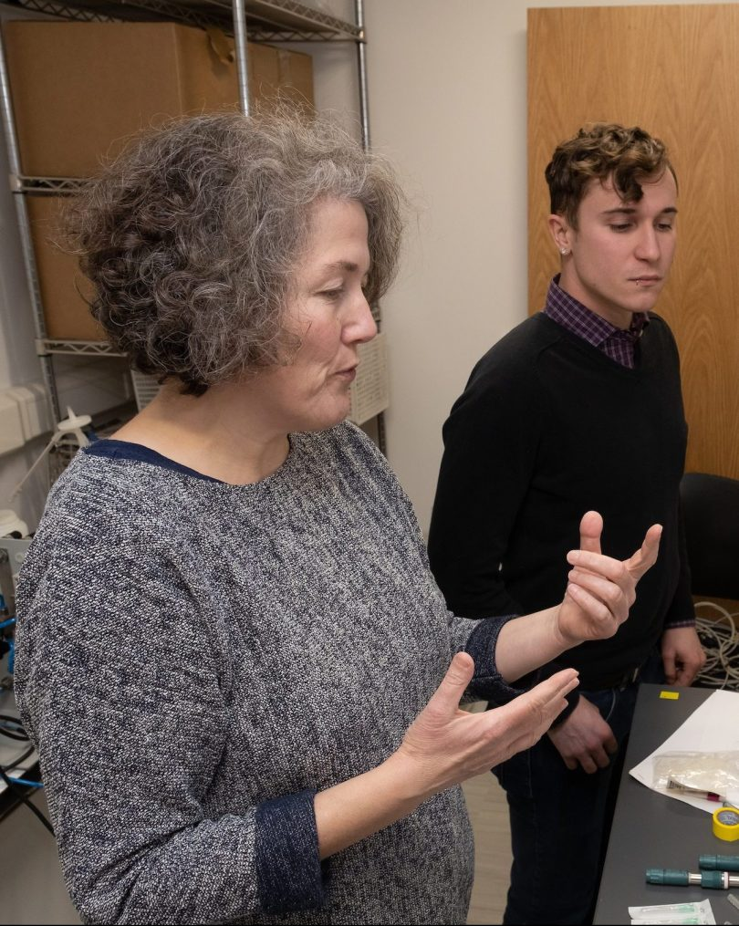 Annette Bollmann explains equipment to a student in her lab.