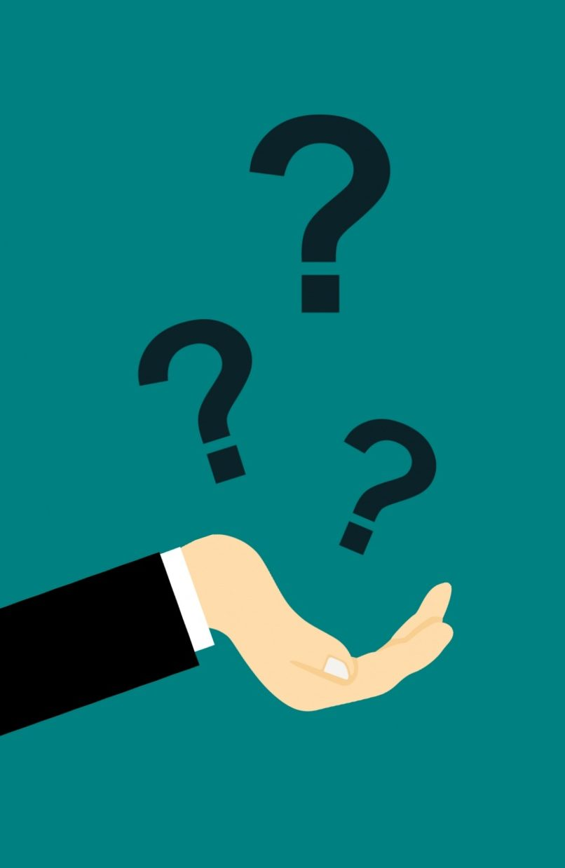 An outstretched hand is positioned to catch falling question marks.